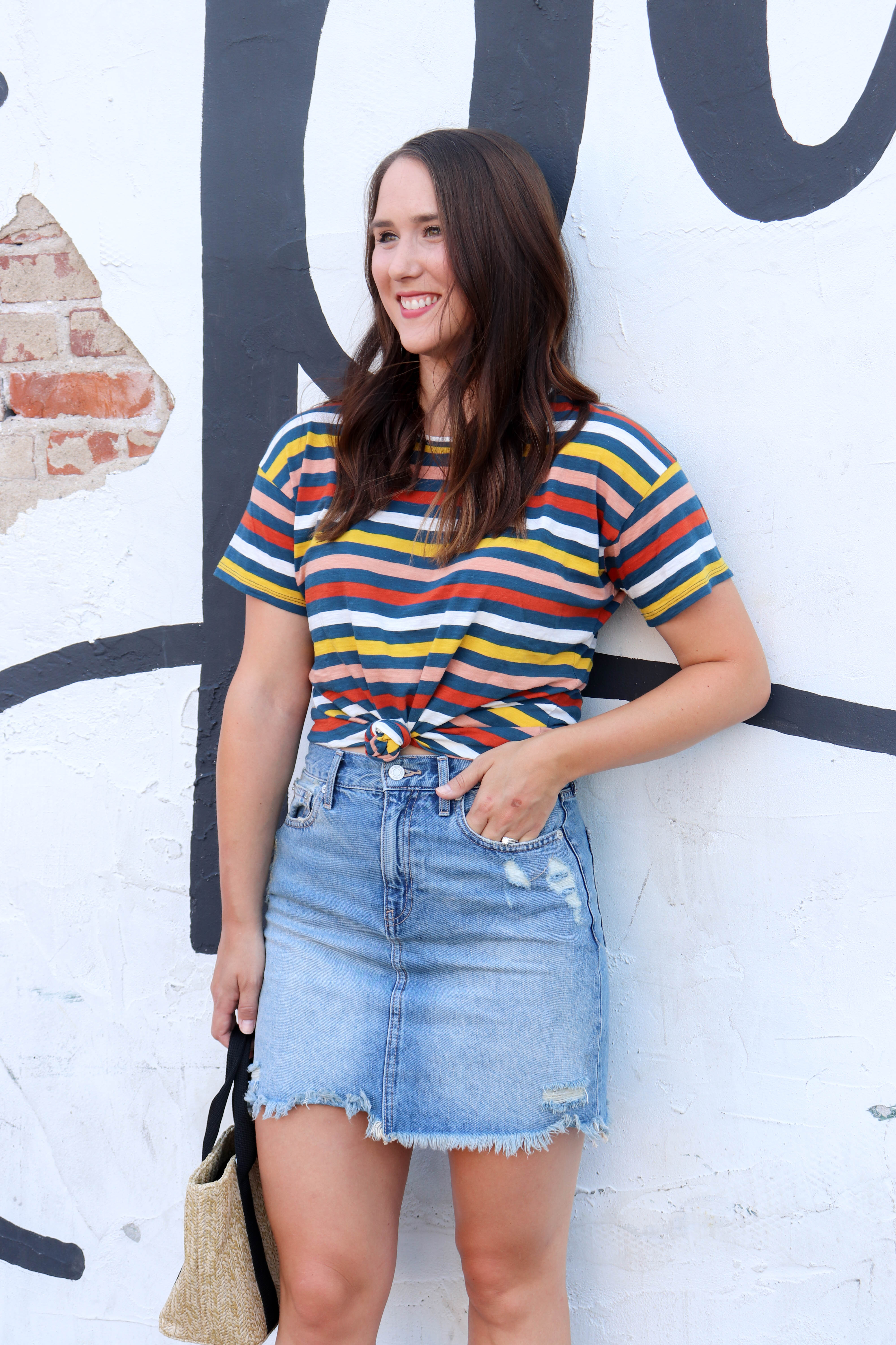 1457f4402ac30d How The Denim Skirt Still Works | 90s Trends | Pointed North